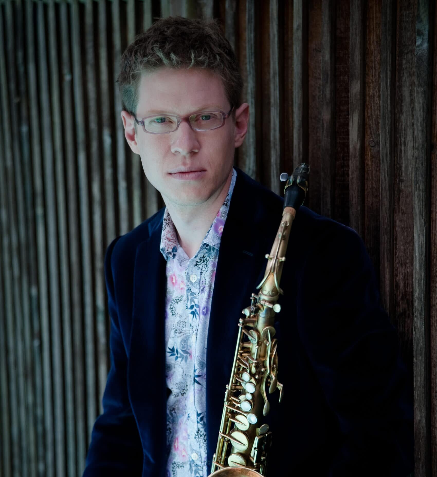 Wallace Halladay standing holding saxophone