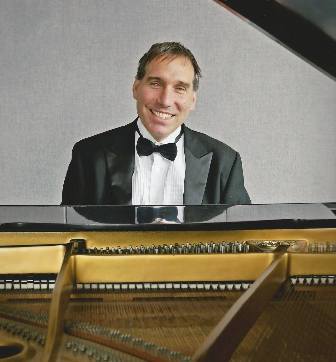 Pianist Frédéric Lacroix smiling at the piano