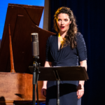 Mireille Asselin singing at a music stand